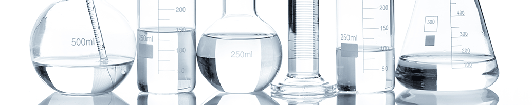 laboratory flasks with clear liquid
